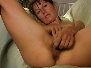 slim brunette woman inside green undies enjoys
