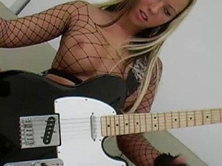 desperate blonde with giant boobs wearing fishnet