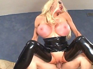 sexy blonde girl in brown latex gets big tits