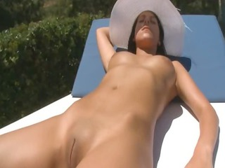 slutty girl posing on the sunbed