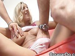bonde mature babe gives a handjob and dick sucking