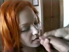red-haired loveliness gives fellatio and facial