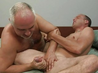 mature gay gives more amateur hunk a handjob on