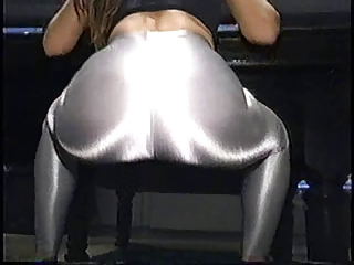 babe inside shiny silver spandex and shoes