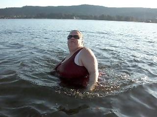 woman flashing at the river.