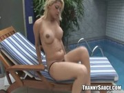 Sexy blonde shemale hottie jerks it by the pool