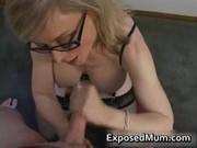 Blond milf in glasses licking hard