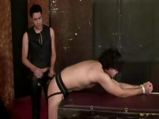 submissive slave acquires spanked by master
