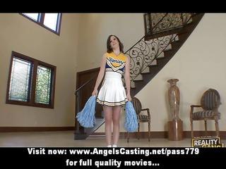 brunette cheerleader flashing brief and doing