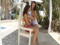 lesbo adore al fresco on the bench kissing