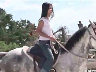 topless eastern  amateur driving a horse asian